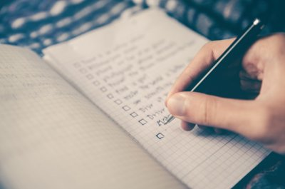 Image of Person Writing List