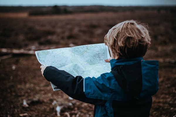 Child reading map