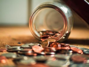 Glass Jar with coins spilling out